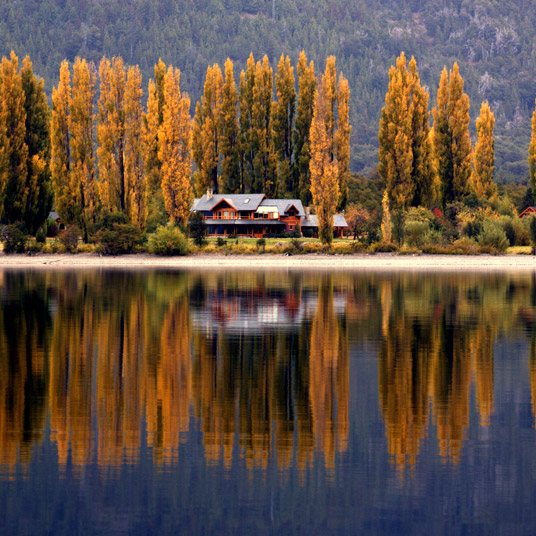 Argentina ecotourism shoreline building with fall colors