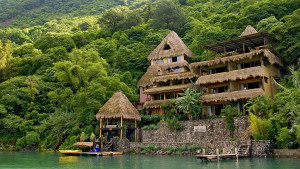 tall lodge in rainforest over lake ecotourism Guatemala
