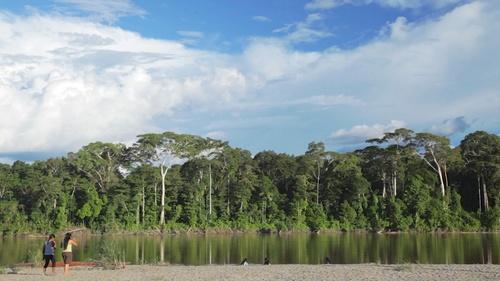 Amazon river shore with people Cofan Ecuador
